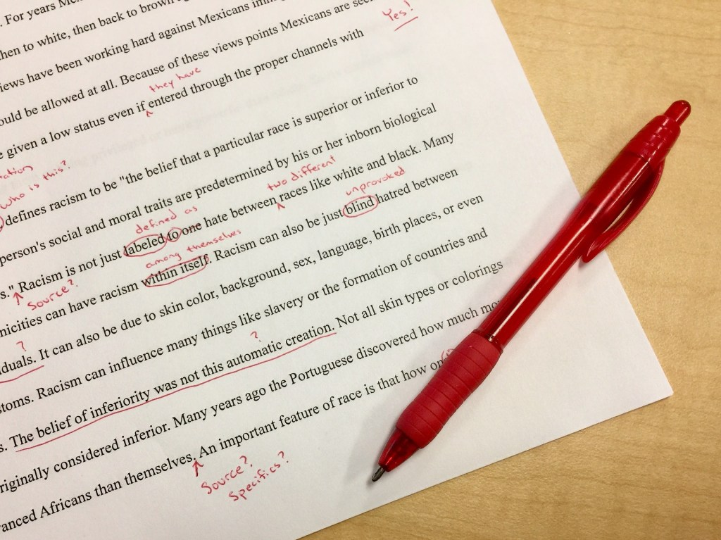 image of text with red ink corrections--editing my manuscript continued during this quiet busy month
