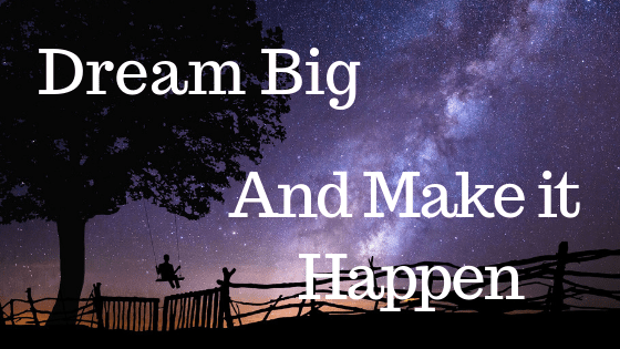 Silhouette of a tree and someone swinging in a swing against a starry night. The words Dream Big And Make it happen are across the image.
