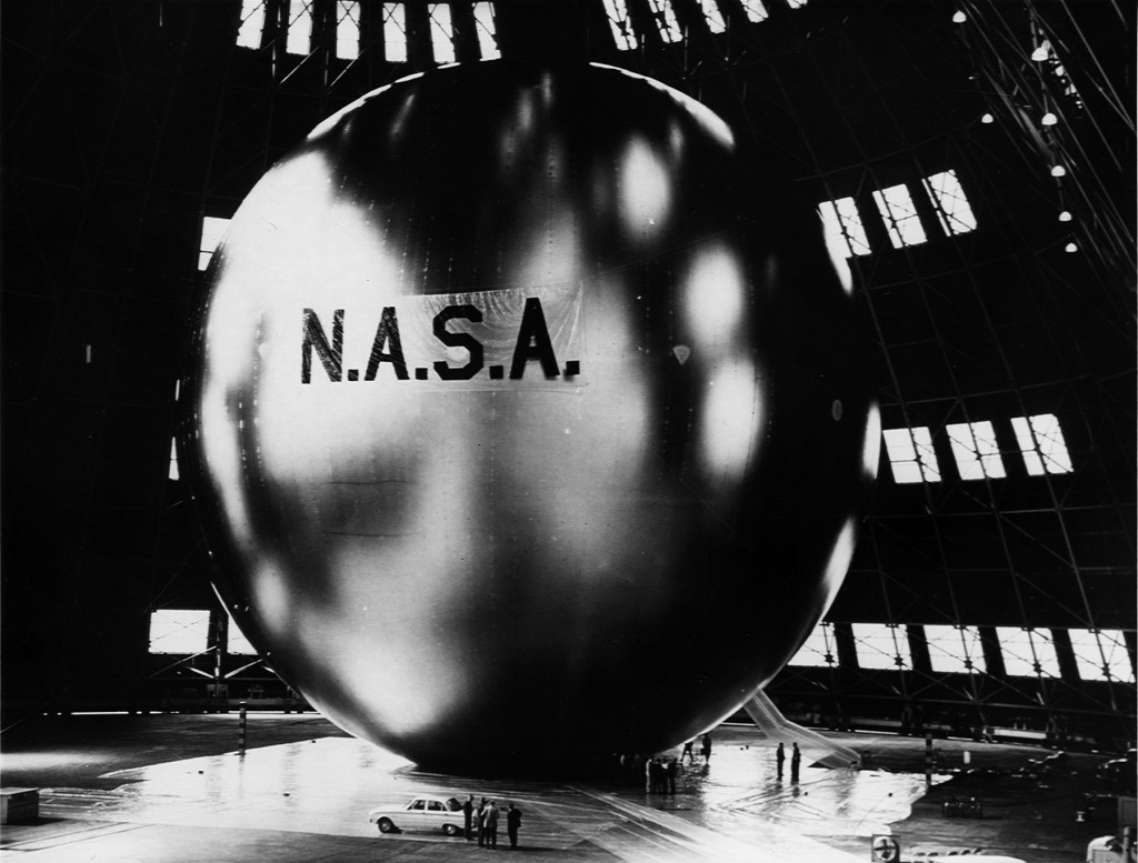 Image of Echo I, a balloon satellite launched by NASA and part of the research that meant my story went to the dogs.