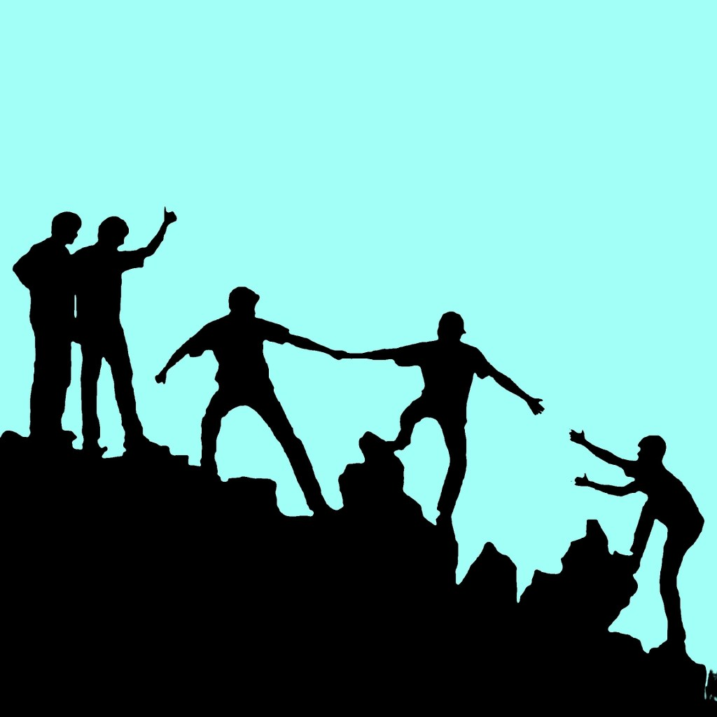 Image of silhouettes of people helping one up a mountain. the best way you can not feel helpless is to help others.