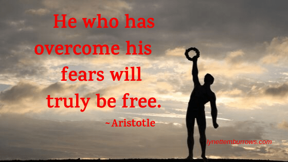 One of 14 quotes that will feed you courage over an image of the silhouette of a Greek olympian holding a wreath up in the air against gray clouds with sunlight bursting through.