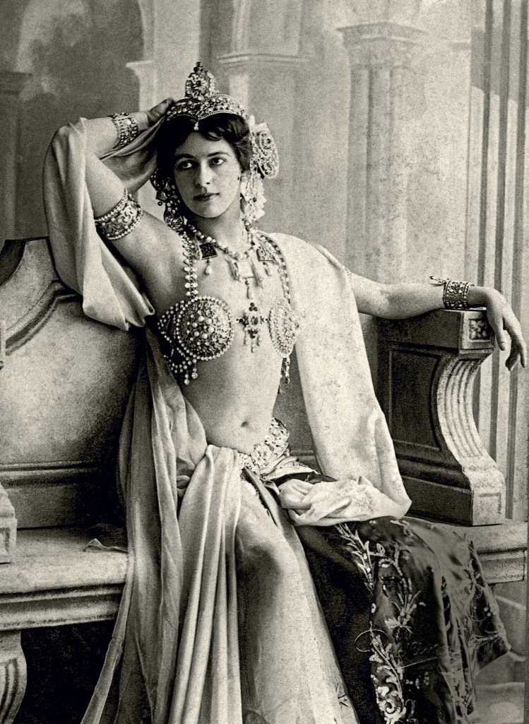 Image of Mata Hari in costume, her life was full of excesses, seduction, and betrayal but was she a real-life villain or scapegoat?