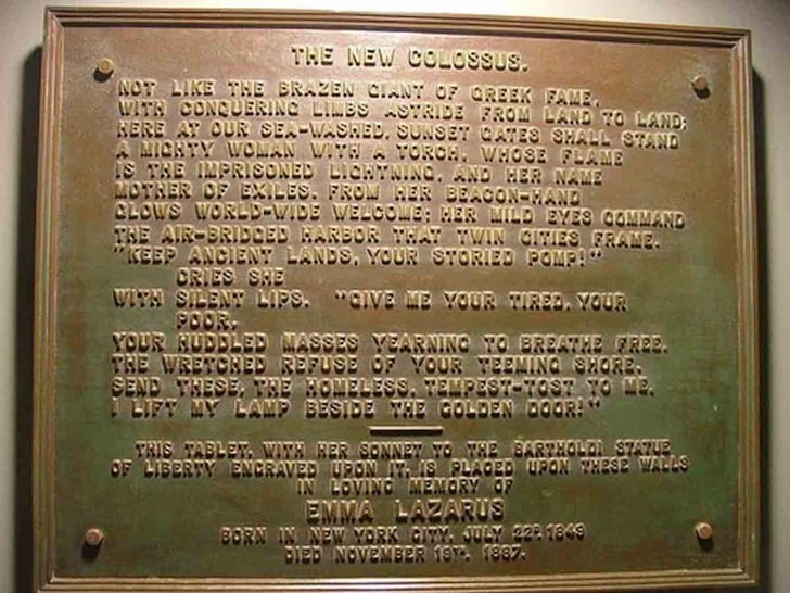 "Image of the plaque inscribed with Emma Lazarus's sonnet ""The New Colossus"" placed on the Statue that is the symbol of freedom and democracy."