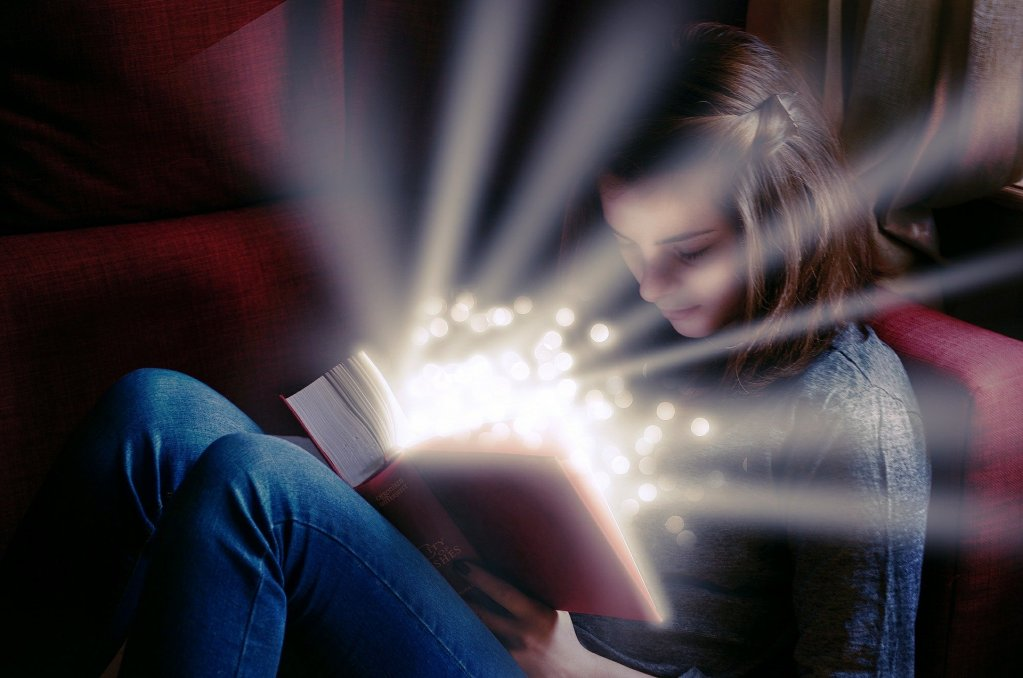 Image of a girl reading a book with stars and light streaming out of the book--much like me looking at my past decade of growth and change.