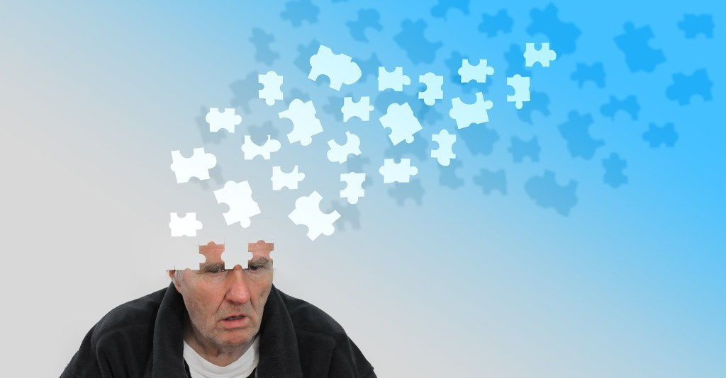 image of a man where the top of his head is puzzle piece that are floating away