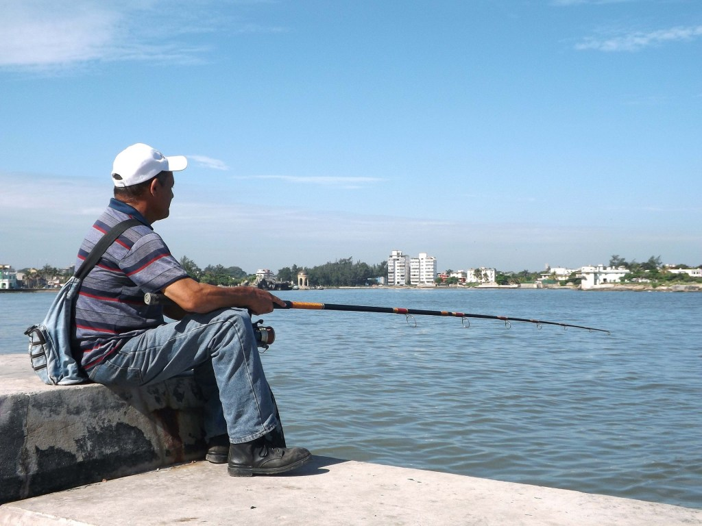 Image of man fishing off a pier you need distraction--try fishing