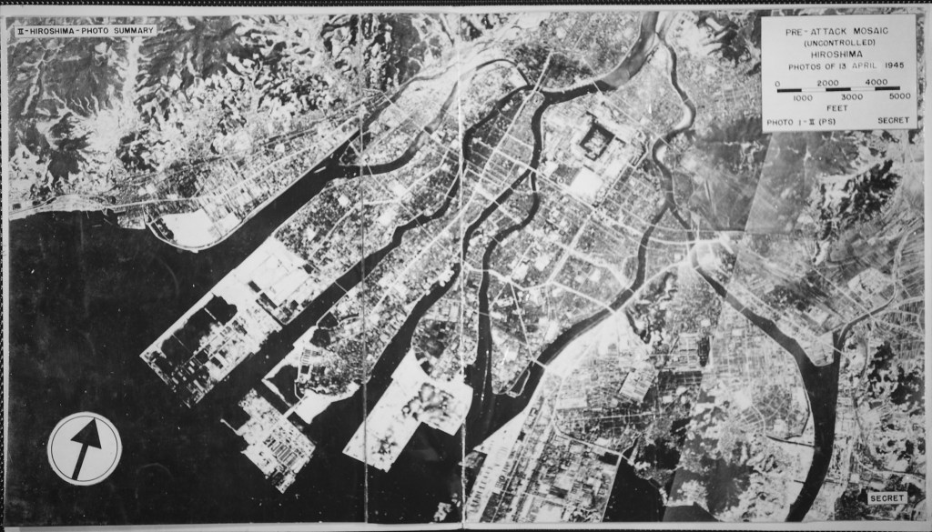 "Image of Hiroshima from the air before the atom bomb ""little boy"" was dropped shows the bay, rivers, large buildings and many roads."