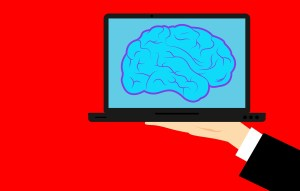 Illustration of a computer screen showing a brain--an idea waiting to become a cyborg