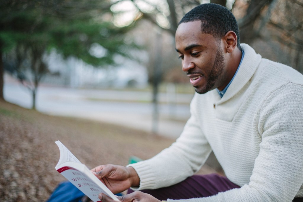 a black man experiencing the mystical adventure of reading for pleasure.