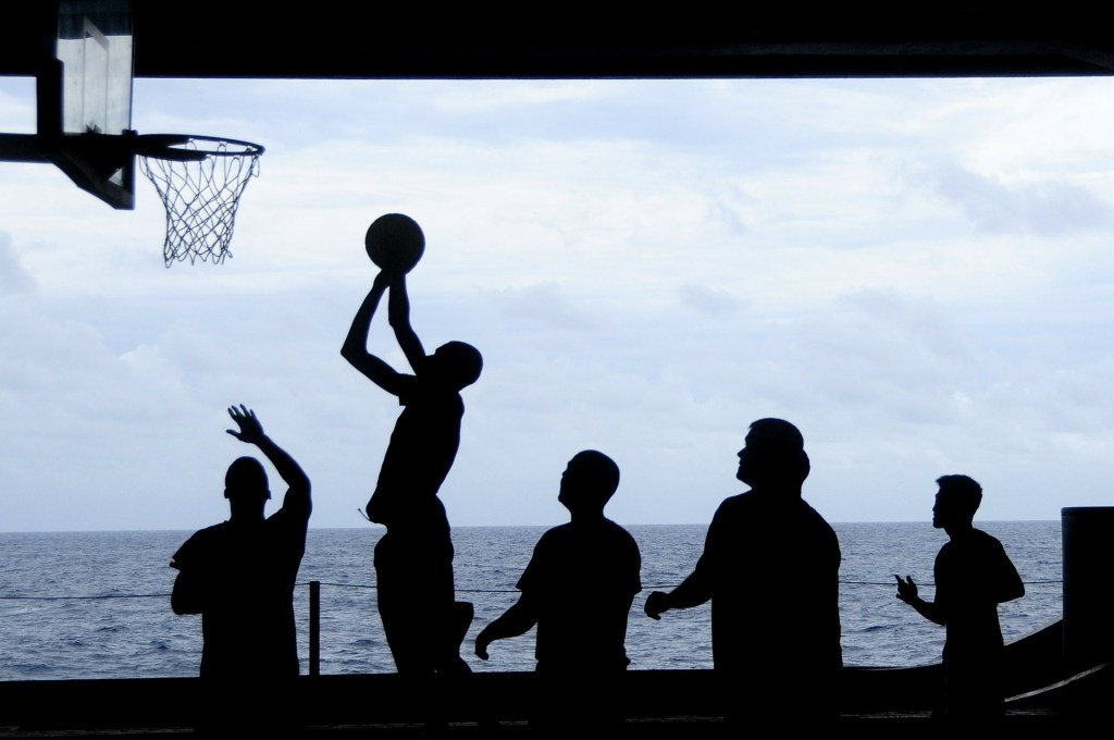 silhouettes of people playing basketball. They make it fun.