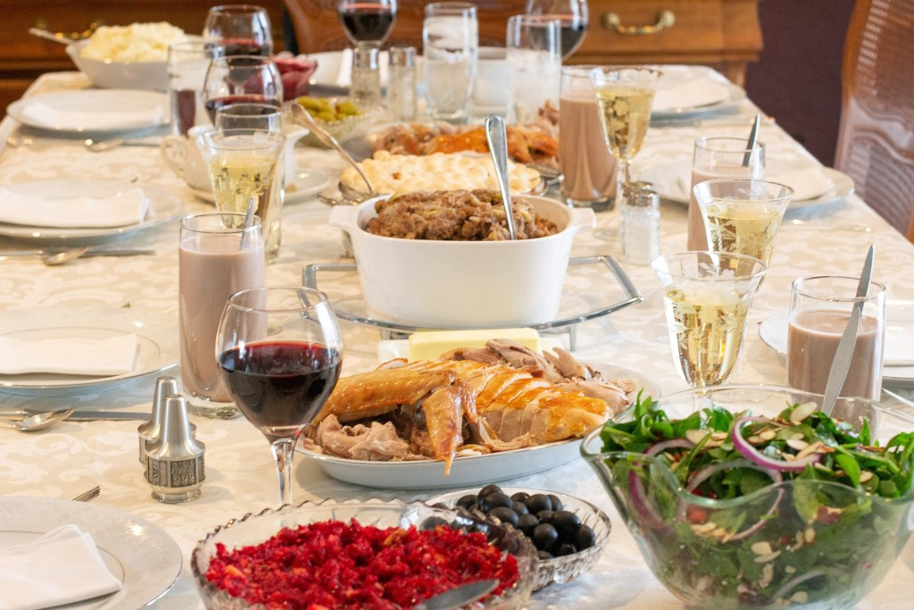 "I""m done eating turkey even if the table in this photograph is of a Thanksgiving table with serving dishes of cranberry sauce, salad, turkey, dressing, potations and other sides. But I'm done eating turkey."