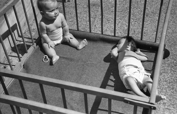 Circa 1950s image of two babies in a wooden playpen wearing nothing but cloth diapers and no way to stay dry--Marion Donovan saw a need but she was more than an inventor for mothers