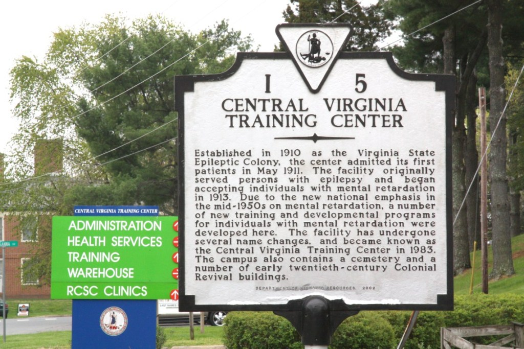 Image of a historical marker which reads Centeral Virginia Training Center.  Established in 1910 as the Virginia State Epileptic Colony the center admitted its first patients in May 1911. It's an example of a writer's serendipity or how research saved my book.
