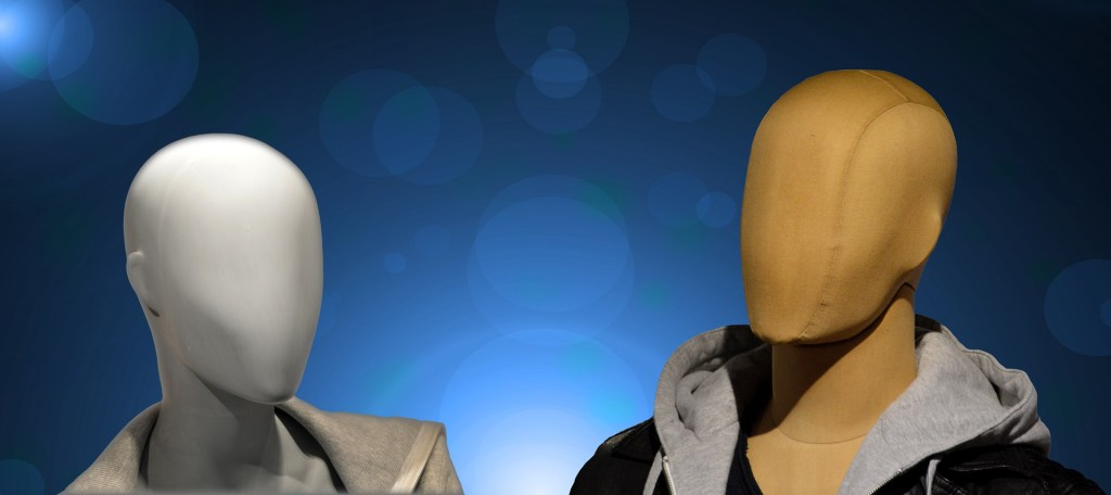 Two manikins with blank faces illustrate how many people try to hide their true selves.