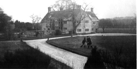 Almer Manor, BB007's UK home, with his children playing on the lawn.