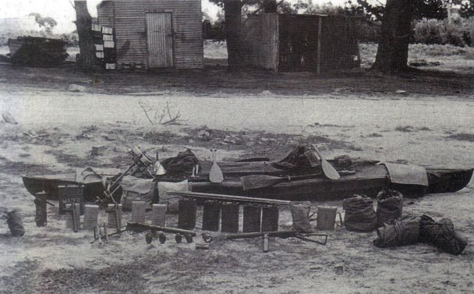 A folboat at Fraser Island School, with equipment and supplies