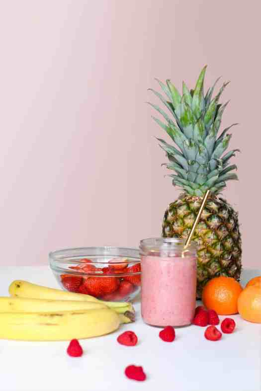 Pineapple with leaves, fruit and smoothie.