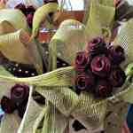 Crimson flowers made of flax in wedding bouquets