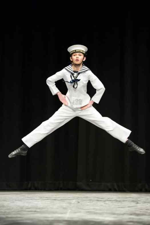 Zara in sailor suit, dancing the hornpipe.