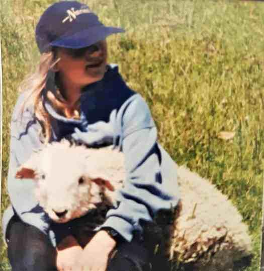 Debbie cuddling her special pet lamb, Floppy.