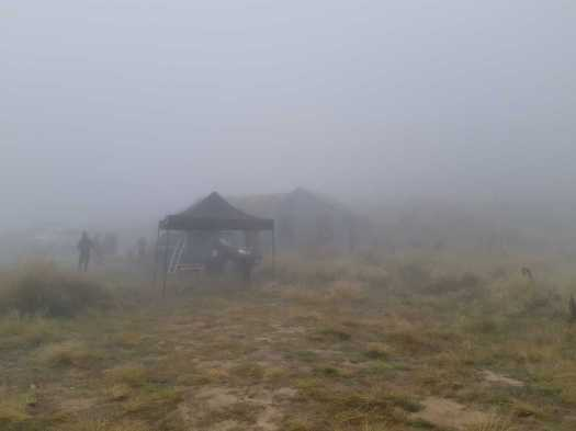 The Revenant tent and the Historic Garston Ski Hut disappear into the thick fog.