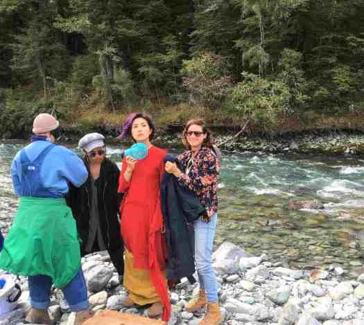 Philippa and co-workers dress Miriam Yeung on a riverbank in the Rees Valley.
