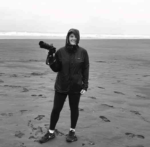 Daisy Thor_Poet wet but happy shooting footage for the Changemakers series on Piha Beach.