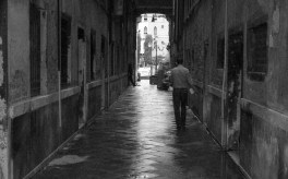 black and white man in Venice alley