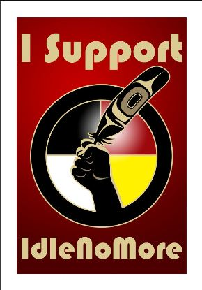 "An uplifted fist holds a feather on a poster. The caption reads ""I support Idle No More."""