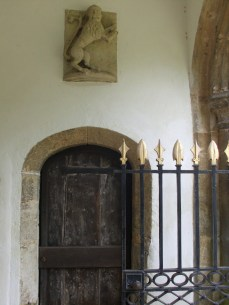 Stone lion in Fotheringhay Church entrance