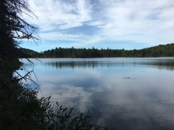 Round Pond with reflecting clouds.