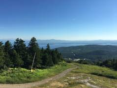 Looking down Upper Trigger/Ramrod and out across Lake Winnipesaukee from the deck at the Panorama Pub on the summit of Gunstock.