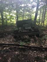 There's this old wreck of a car/truck on the Round Pond trail.