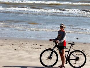 lynn-riding-bike-on-beach-2