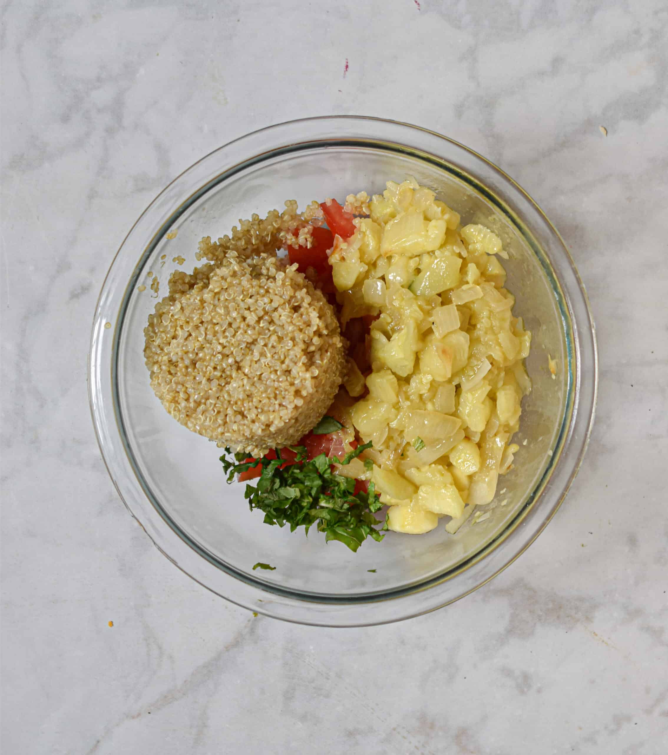 mix the quinoa, tomatoes, basil, and sautéed onions and zucchini together