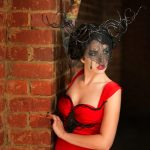 Arien, layered red gown, with twisted black horns with crytals and a black lace veil.