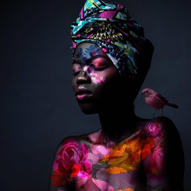 Olivia Sang | My Love For Modelling And The Realities Of It - Lysa Magazine model Olivia Sang with body art work of colorful birds painted on her and a bird sitting on her shoulder