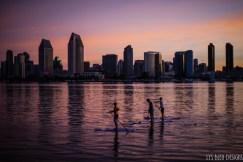 san diego skyline sunrise paddleboarders