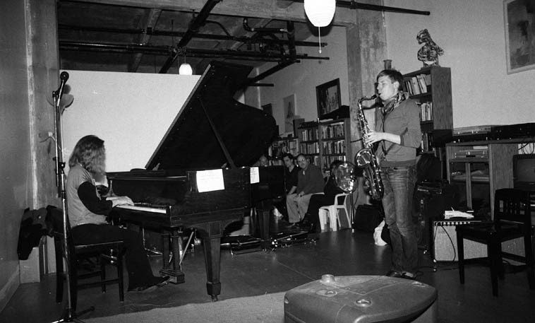 Connie Crothers and Birgitta Flick -- This is toward the end of the long day of music, probably 9:30, so  the crowd has thinned out -- November 16, 2o14 -- photo by Mark Weber  (you can see George McMullen  and Virg Dzurinko sitting)(George played with Connie next)