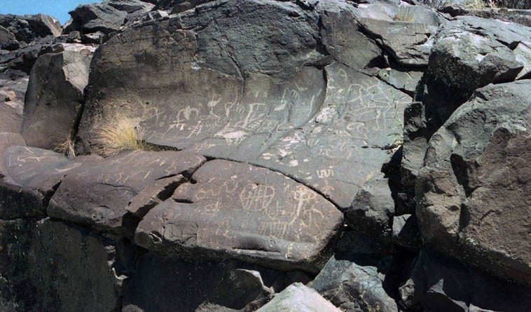 Shoshone petroglyphs circa 2500 years ago (and some as old as the end of the last ice age 16,000  years ago) ---- Coso Mountain Range, China Lake -- May 18, 1985 -- photo by Mark Weber in search of  the first poems