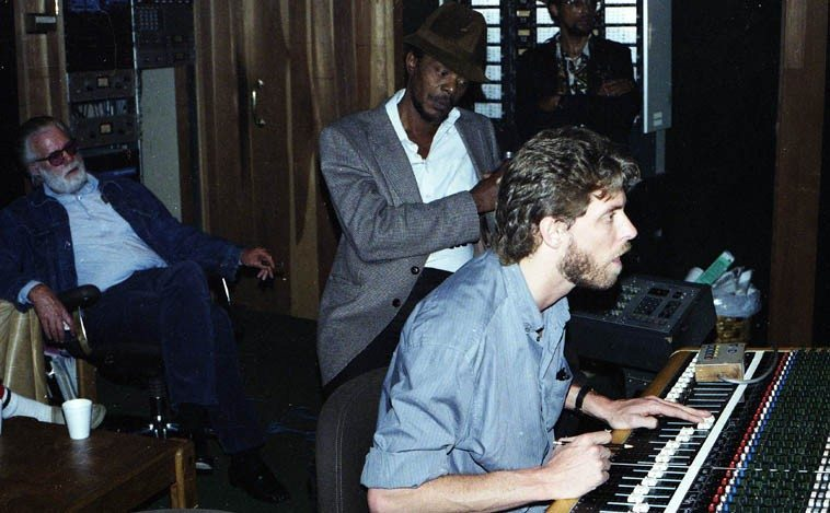 Mad Hatter Studios (Chick Corea, owner), Griffith Park Blvd, Silverlake, Los Angeles -- recording  session for Jesse Sharps album SHARPS AND FLATS (Nimbus West 3702C) -- Tom Albach,  producer (with cigar); Horace Tapscott looking over engineer's shoulder; and the engineer I  believe is Dennis Moody (there is one other engineer in subsequent photos from this session) -- March 26, 1986 -- photo by Mark Weber