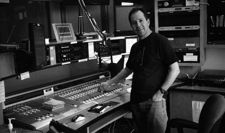Paul Gonzales in the control room at KUNM -- 12:48 (noon) March 15, 2o10 (every Monday)  -- photo by Mark Weber ---- We're going through a strange period of time when it's hard to find  prospective hosts who want to be jazz disk jockeys, you know? Good ones, like Paul who is  also an A-List trumpeter & a virtuoso on the cuica ---- Paul has been spinning disks and doing  interviews at KUNM something like 15 years and I catch his show almost always, because  I always learn something, besides of course having a great musical experience, which is why  we listen in the first place, right?