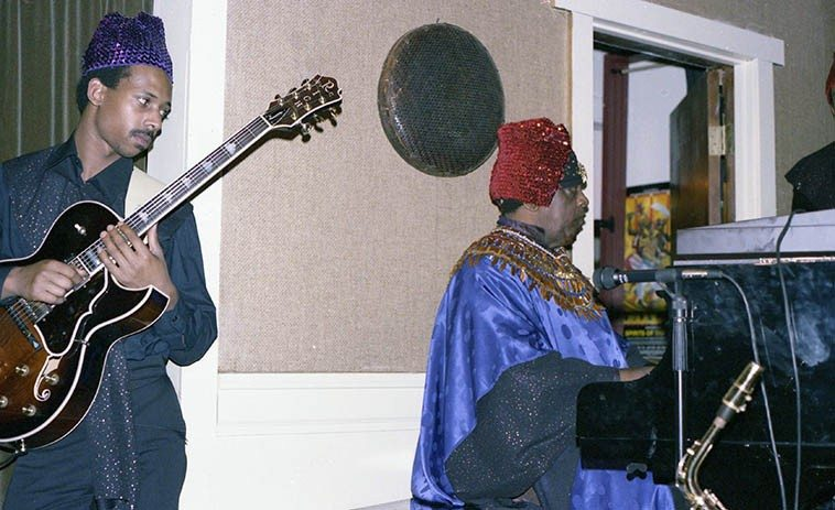 I didn't catch the guitarist's name ---- Sun Ra: What are those people called that travel between two  worlds? priests? mediums? clairvoyant? ---- December 4, 1985 Oakland California -- photo by Mark Weber