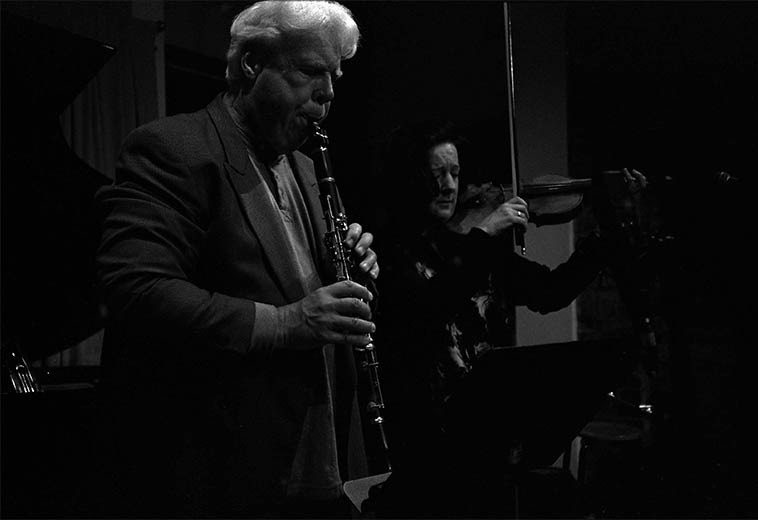 Bill Payne on Eb clarinet and Eva Lindal on violin as part of trio with Carol Liebowitz, piano --  concert at Scholes Street Studio, Brooklyn, to celebrate release of their CD -- May 8, 2o15 --  photo by Mark Weber