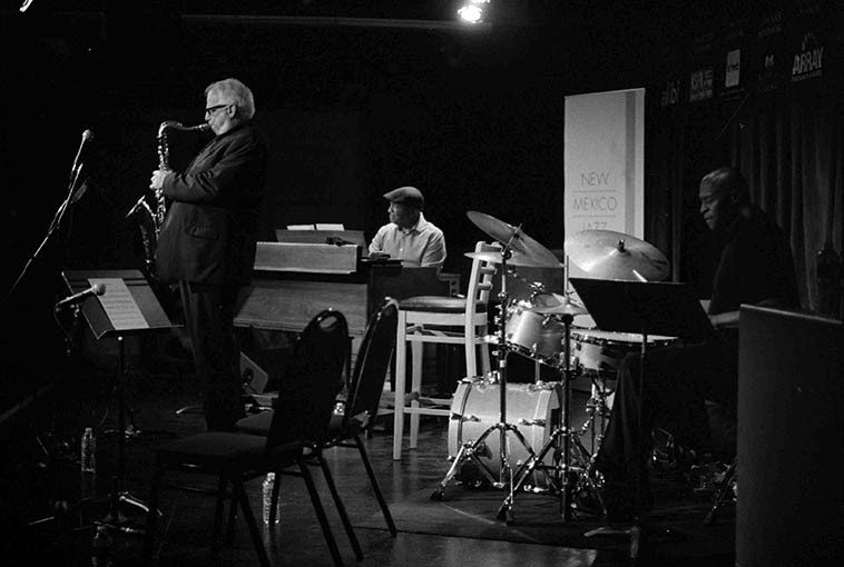 Doug Lawrence New Organ Trio at the Outpost Performance Space during the New Mexico Jazz Festival -- July 26, 2o15 ------ with two band mates from the Basie Orchestra: Bobby Floyd, B3; and David Gibson, drums ---- those two empty chairs on stage are for guests Bobby Shew and Paul Gonzales, trumpets -- photo by Mark Weber