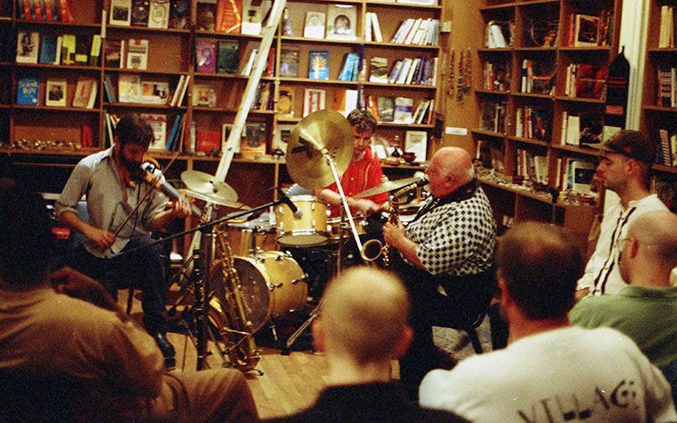 Joe Maneri Trio -- June 28, 1997 at Biblios (bookstore), 317 Church, downtown NYC (Mat Maneri, electric six string violin; Randy Peterson, drumset) ---- photo by Mark Weber ------- I remember this night I got semi-lost endeavoring to get home back up to 113th Street --- not being a New Yorker I didn't know the subways close many of their stations late at night downtown and I wandered around for seemingly hours (I have a variety of spatial dyslexia) looking for a get-on, I can't tell north from south (Max Roach had the same condition, I found out one night in a cab with him!)(dyslexia refers to words, so is not exactly the right term)