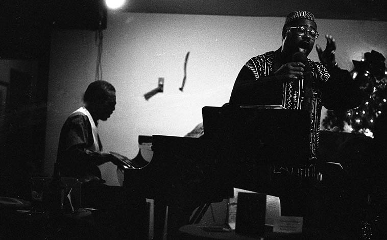 """Horace Tapscott & Dwight Trible at Catalina's, Hollywood, California -- December 21 or 22, 1995 -- photo by Mark Weber -- These nights were professionally recorded and have never been released -- Horace brought an octet for the occasion -- I was in California visiting, having moved away in 1986 and hadn't seen Horace in all that time -- When he spotted me in the audience, he got off the piano walked over to my table and said """"You're busted,"""" laughing and we both laughed and I said, """"Uh, Horace, you know the tapes are running."""""""
