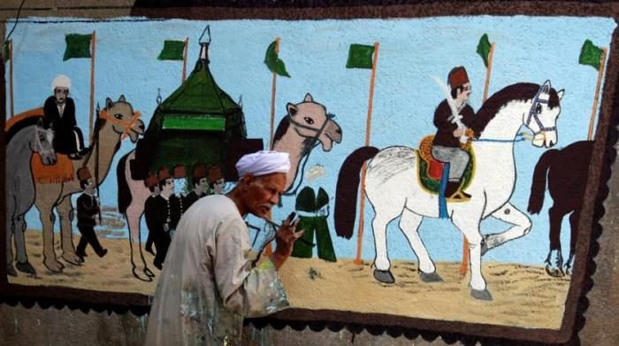 Image result for Egyptian artist paints murals on houses to celebrate haj