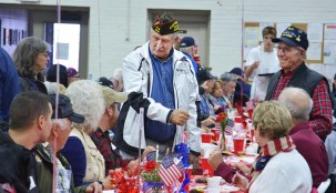 """Robin Hart/robin.Hart@amnews.com Robert """"Doc"""" Daugherty Ret. Cmsgt. and commander of the Kentucky Veterans of Foreign Wars from Morgantown, greets fellow veterans and their spouses on Monday at Danville's Natonal Guard Armory."""