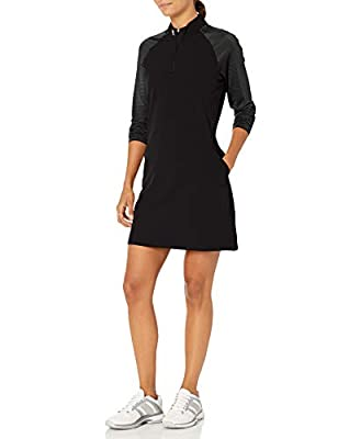 Zip mock collar Lightweight, stretchy fabric Half-zip golf dress with pockets Front pockets and one back zip pocket Pleat on back